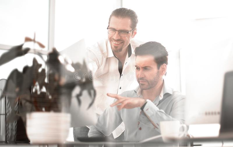 Creative designer talking with his colleague stock photos
