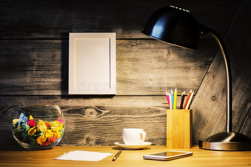 Creative desk with picture frame royalty free stock photo