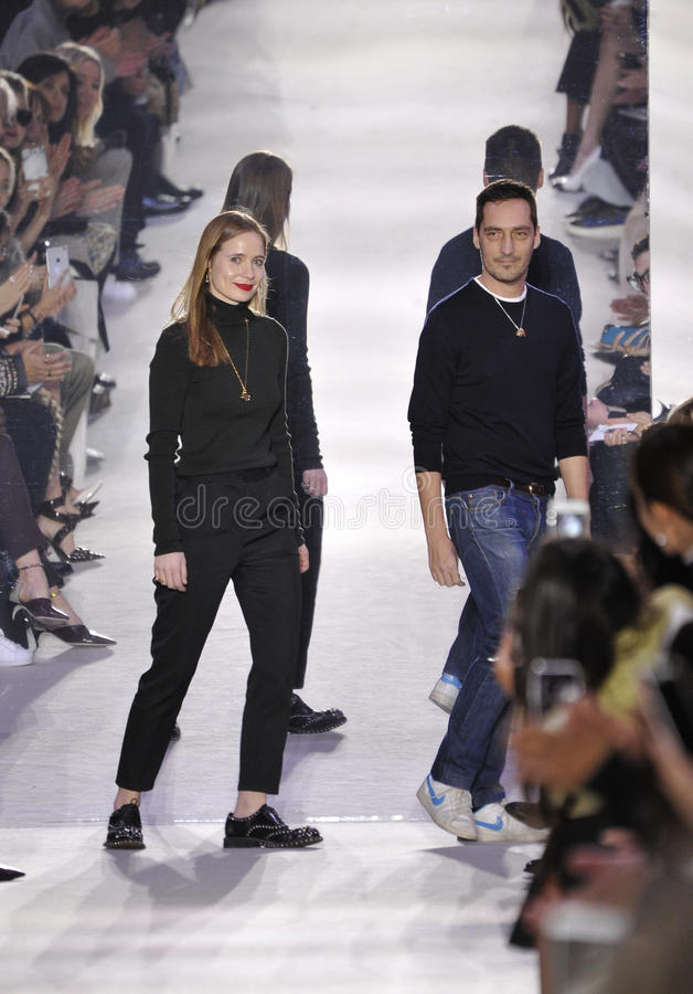 Creative Directors Lucie Meier and Serge Ruffieux walk the runway during the Christian Dior show. PARIS, FRANCE - MARCH 04: Creative Directors Lucie Meier and stock photography