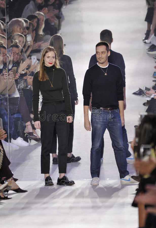 Creative Directors Lucie Meier and Serge Ruffieux walk the runway during the Christian Dior show. PARIS, FRANCE - MARCH 04: Creative Directors Lucie Meier and royalty free stock images