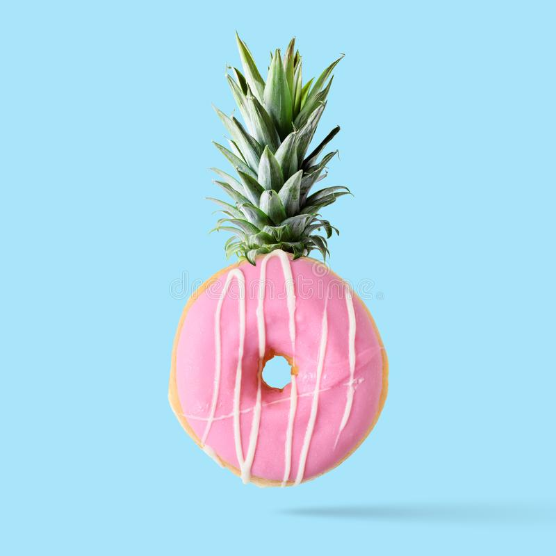 Creative disposition of donut pineapple on bright background. Minimal food concept stock photos