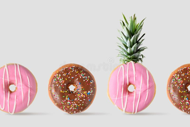 Creative disposition of donut pineapple on bright background. Minimal food concept royalty free stock photography