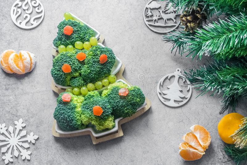 Creative edible Christmas tree made of fresh broccoli.Holiday ideas. New year food background top view . holiday, celebration, stock image