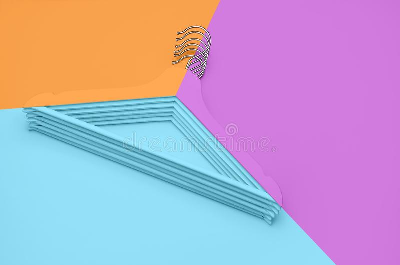 Creative fashion concept. Flat lay top view colored wooden hangers on blue pink orange neon background minimalism style. Pop-art. Sale discount store shopping royalty free stock photography