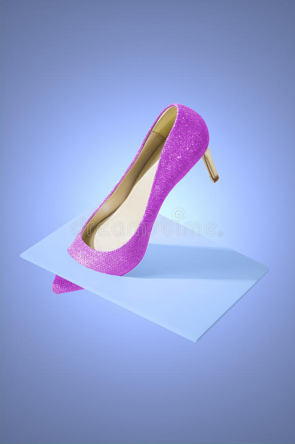 Creative fine art display of a stiletto shoe stock photography