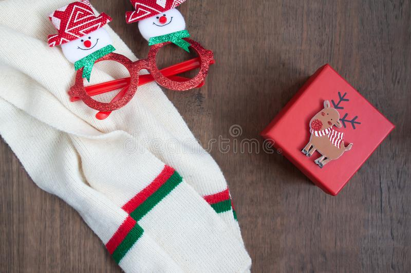 Creative flat lay of Christmas concept with fashion items and gift box royalty free stock image