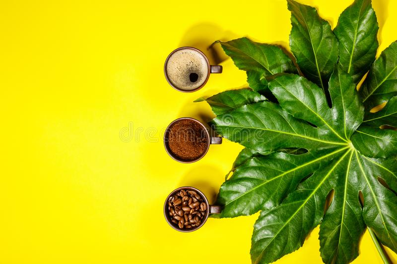 Coffee composition on yellow background stock photography