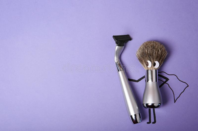 Creative flat lay composition with men`s shaving accessories and space for text. On color background stock photography