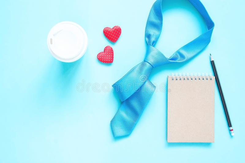 Creative flat lay of Father`s Day concept. Necktie and notebook  on pastel colour royalty free stock images