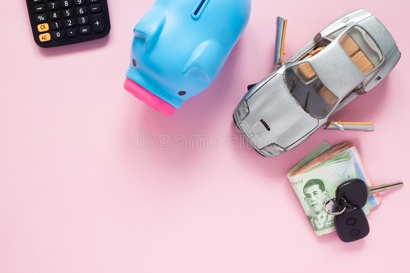 Creative flat lay of finance or car loan concept with Thai bankn. Otes on pink background stock photo