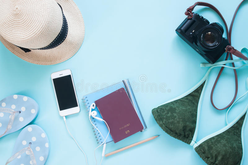Creative flat lay of passport, camera and woman accessories on pastel color background royalty free stock photos