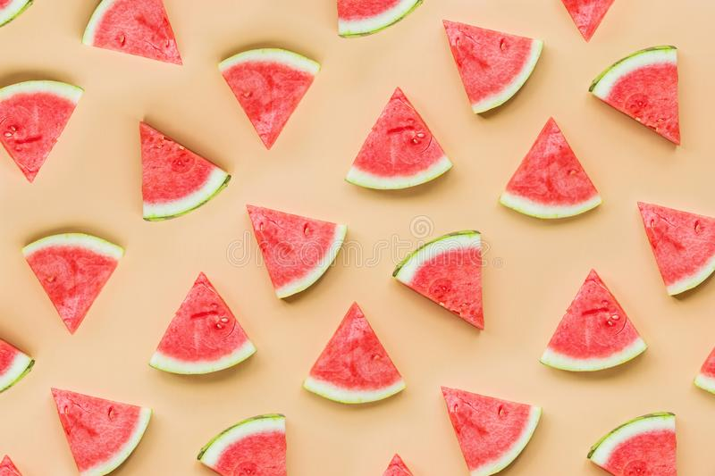 Creative flat lay top view of fresh watermelon slices on orange table background with copy space. Minimal summer fruits pattern stock image