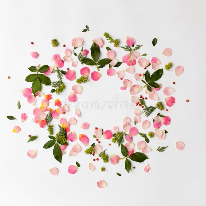 Creative floral round frame with rose petals and green leaves royalty free stock image