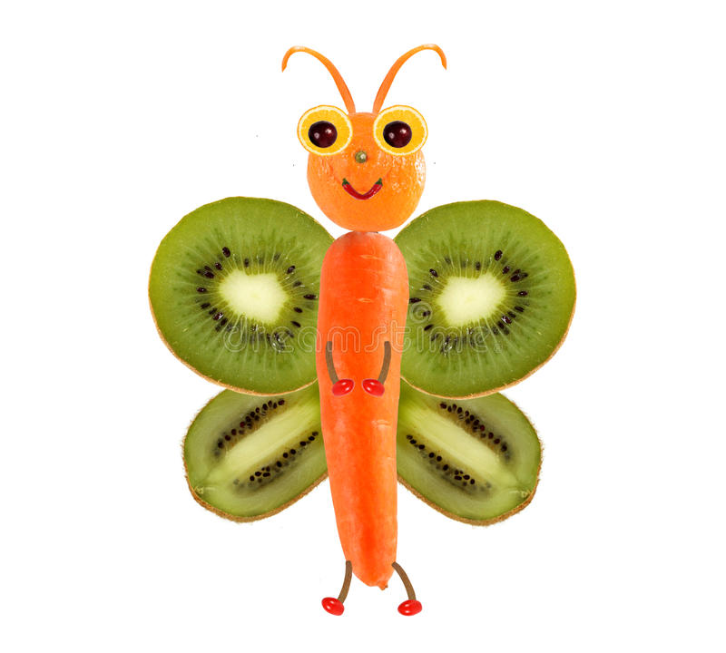 Creative food concept. Funny little butterfly made of fruits and royalty free stock photography