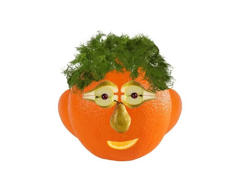 Creative food concept. Funny portrait made of  orange, vegetables and fruit royalty free stock photography