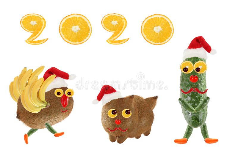Creative food concept. Funny vegetables and fruits. Happy New Year 2020 stock photos