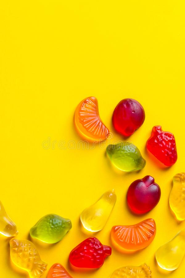 Creative food poster banner card template. Gummy jelly candies in shape of different summer tropical fruits arranged in pattern stock photography