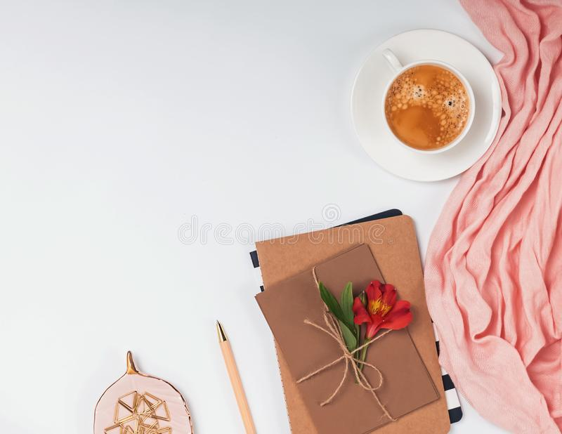 Creative frame with coffee, envelopes and flower. Stylish femine flat lay stock photos