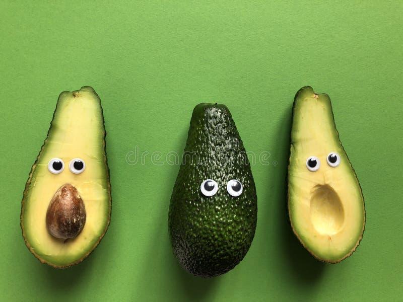 Creative funny food concept, avocados royalty free stock photos
