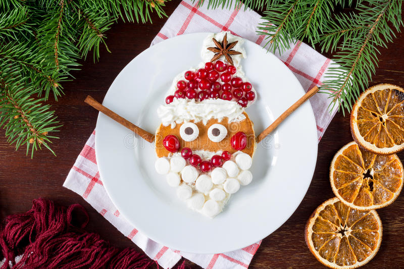 Creative funny food for kids: cheerful Santa Claus pancake stock photo