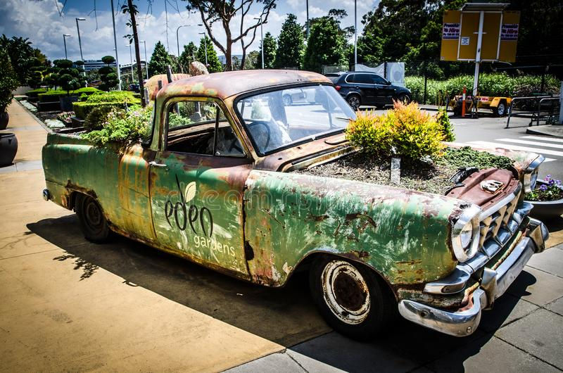 Creative garden bed on abandoned vintage truck at in front of Eden gardens, Macquarie Park, new south wales. royalty free stock image
