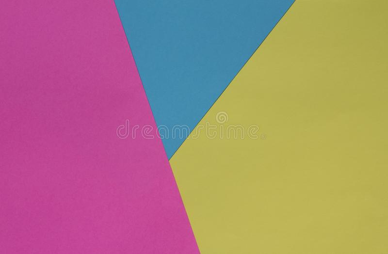 Creative geometric paper background. Pink, blue, yellow colors. royalty free stock images