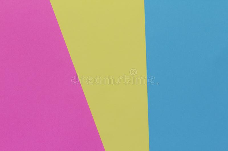 Creative geometric paper background. Pink, blue, yellow colors. royalty free stock image