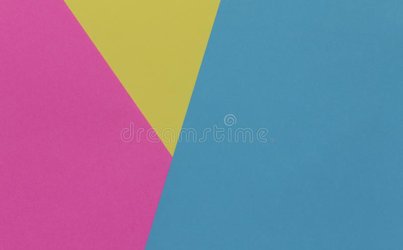 Creative geometric paper background. Pink, blue, yellow colors stock images