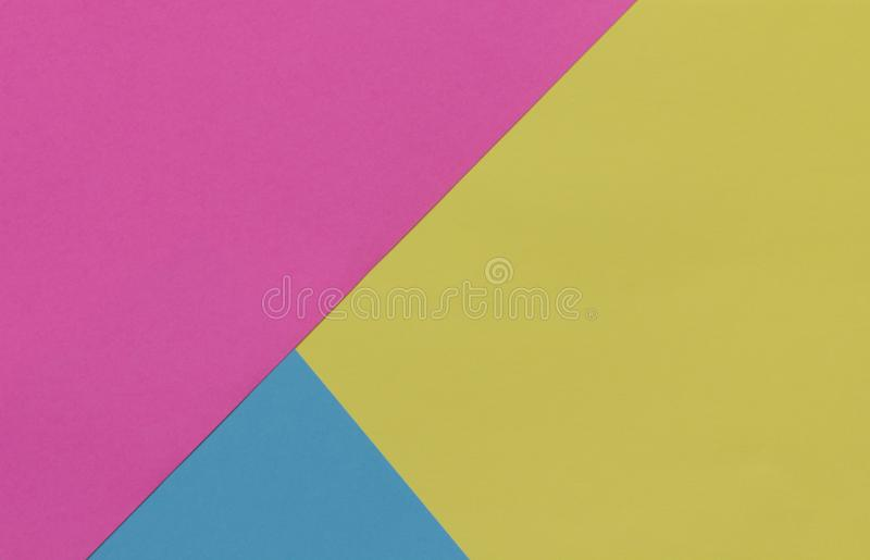 Creative geometric paper background. Pink, blue, yellow colors. royalty free stock photo