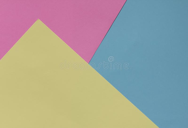 Creative geometric paper background. Pink, blue, yellow pastel royalty free stock image