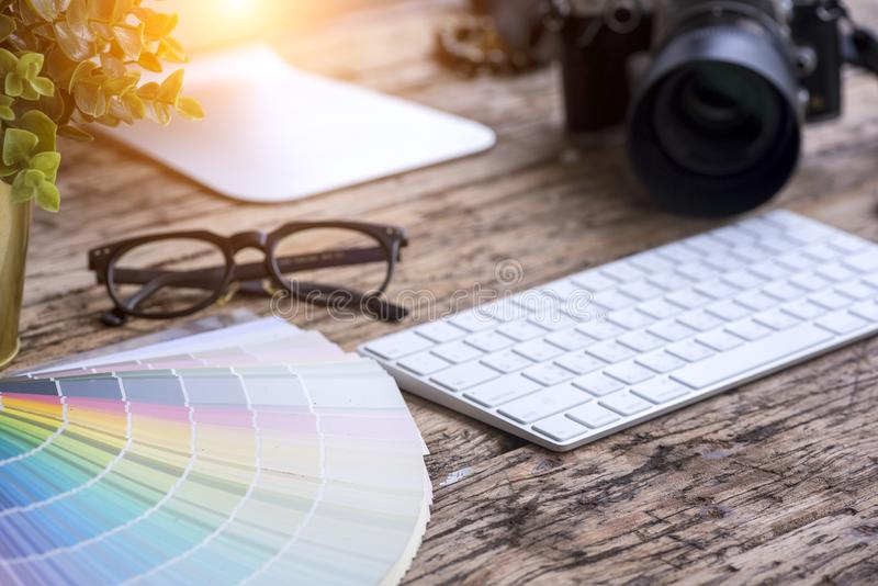 Creative graphic Designer office table. Creative Designer office table, Color palette, digital camera and work station royalty free stock image