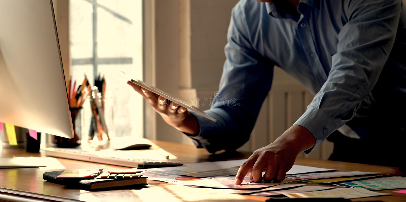 Creative graphic designer working with tablet stock photos