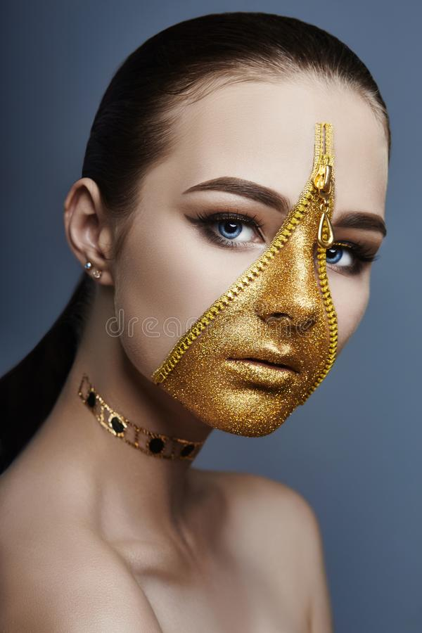 Creative grim makeup face of girl Golden color zipper clothing on skin. Fashion beauty creative cosmetics and skin care halloween royalty free stock photography