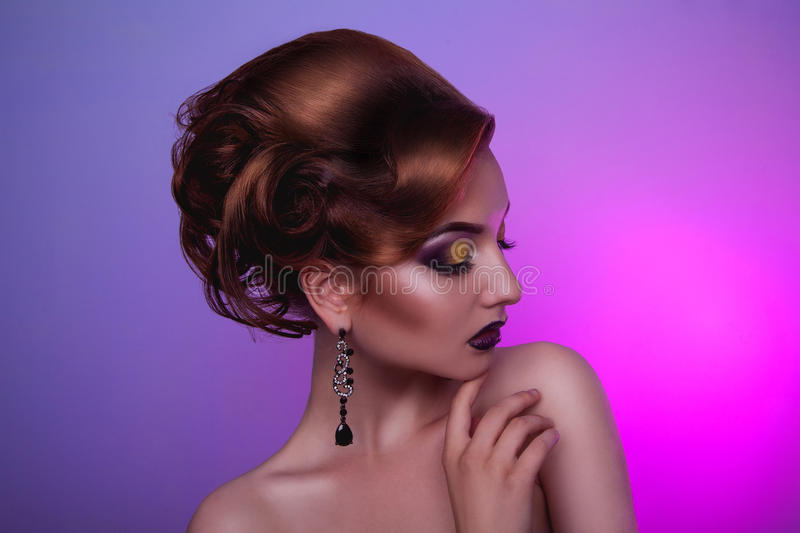 Creative hairstyle and professional make up on fashion woman. In studio royalty free stock photography