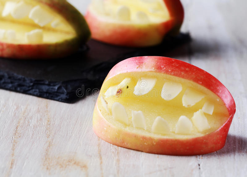 Creative Halloween apple with teeth stock photo