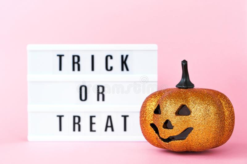 Creative Halloween Day composition. Holiday celebration pumpkin and lightbox stock photography
