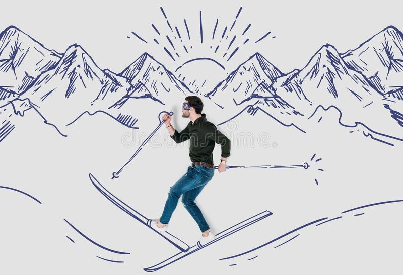Creative hand drawn collage with man skying in snowy mountains stock photo