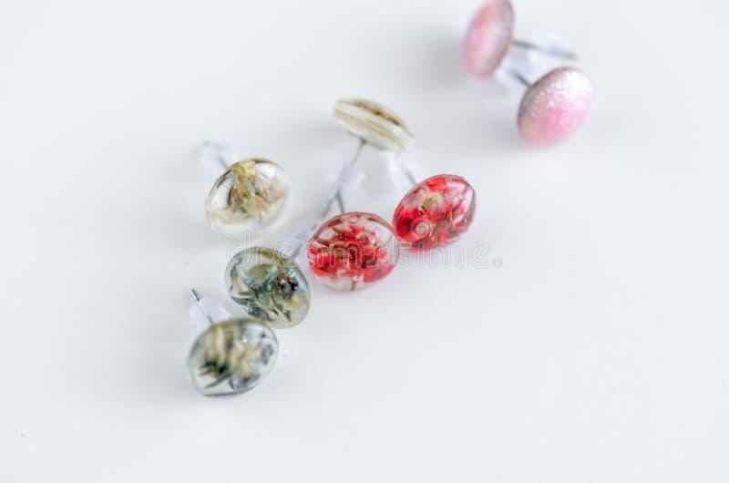 Creative handmade stud earrings. Jewelry background royalty free stock photos
