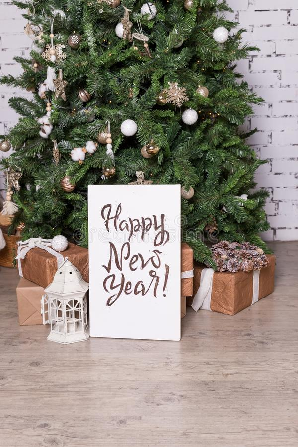 Creative Happy New Year greeting card. Hand drawn text, Christmas tree with unique lettering hipster poster. Golden stock images