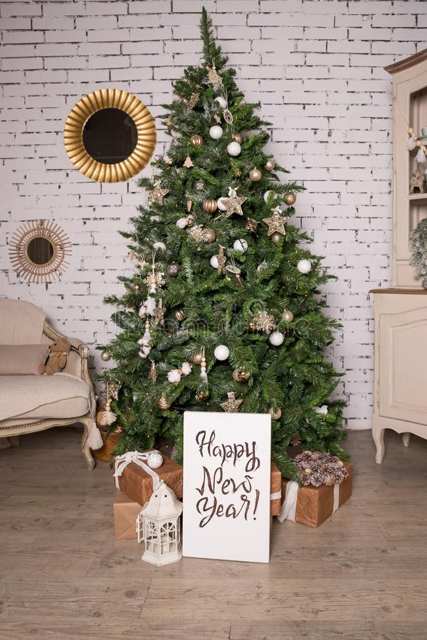 Creative Happy New Year greeting card. Hand drawn text, Christmas tree with unique lettering hipster poster. Golden royalty free stock image