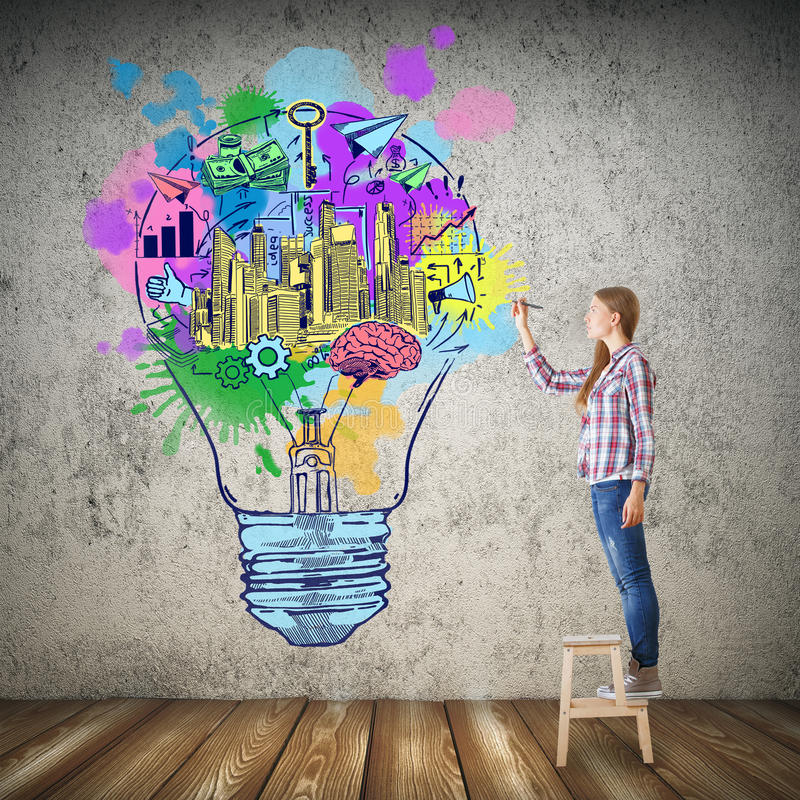 Creative idea concept. Girl drawing colorful lamp in concrete room with wooden floor. Creative idea concept stock image