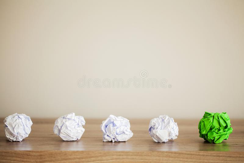 Creative idea concept.Inspiration, New idea and Innovation concept with Crumpled Paper on wood background royalty free stock images