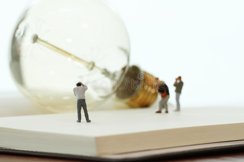 Creative idea concept - miniature photographer stock photos