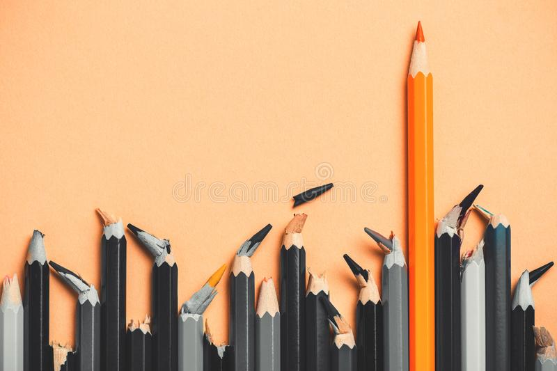 Creative idea, the concept of the strength of a person`s character, broken people against a strong successful man, a background o. F pencils royalty free stock photos