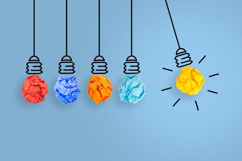 Creative Idea Concepts Light Bulb with Crumpled Paper on Blue Background royalty free stock image
