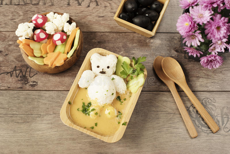 Creative idea for kids lunch or dinner. Children animal food. Bath with rice bear and cream soup. Mushrooms of radishes royalty free stock photos