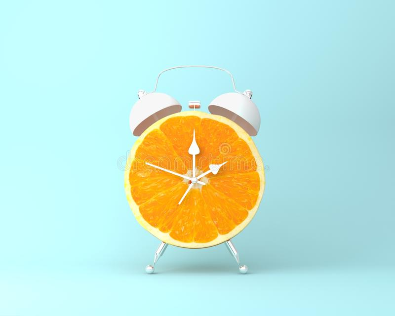 Creative idea layout fresh orange slice alarm clock on pastel bl. Ue background. minimal idea business concept. fruit idea creative to produce work within an royalty free stock images