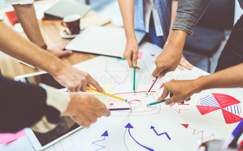 Creative idea teamwork concept. Group of multiethnic diverse team, business partner, or college students in project meeting. At modern office. Five people royalty free stock image