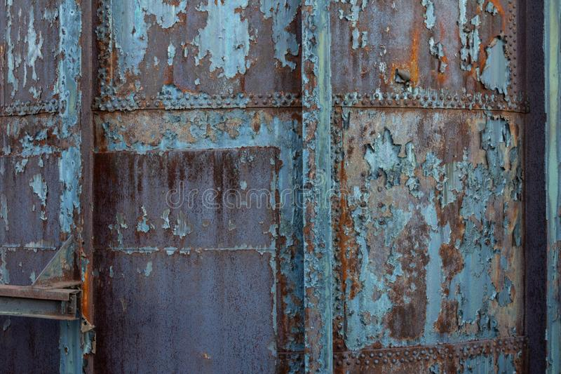 Creative industrial background with rusty metal, rivets, and peeling paint patinas. Horizontal aspect stock images