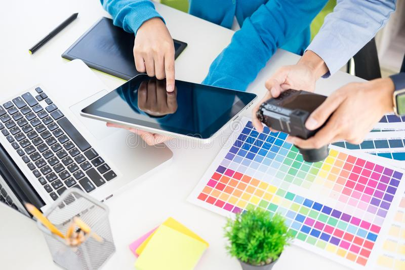 Creative or Interior designers teamwork with pantone swatch and building plans on office desk, architects choosing color samples royalty free stock image